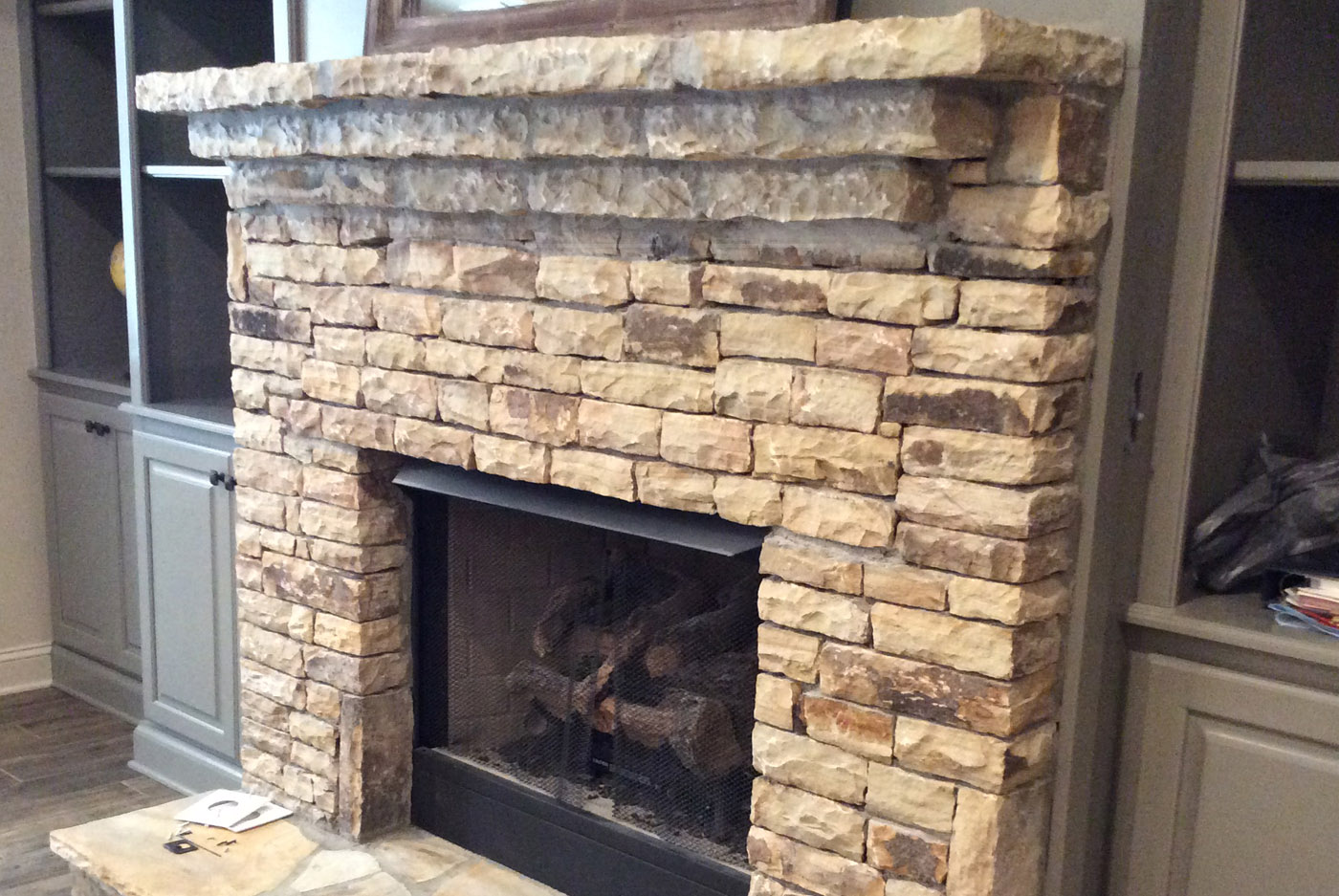 stone on top of brick fireplace