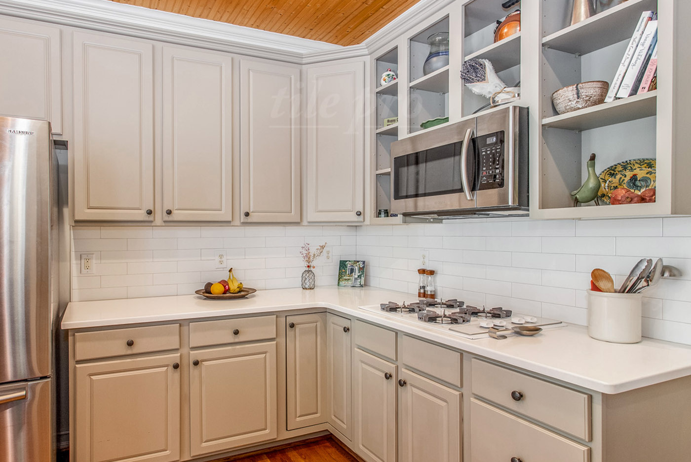white glass subway tile backsplash